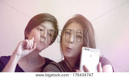 Two Happy Photogenic Asian Womans Talking Selfie With Phone