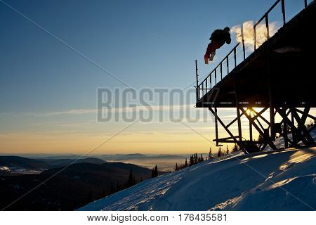 Freerider jumping from the bridge in Siberia
