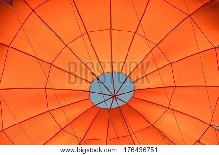 Photo of a red parachute from inside during flight