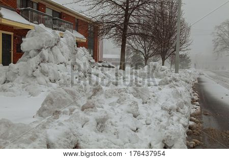 House In Residential Area After Snow