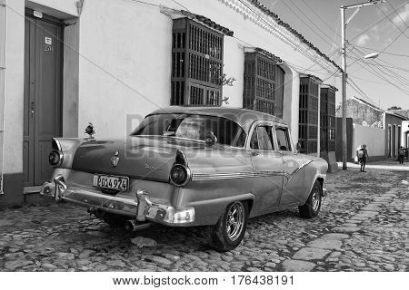 Trinidad Cuba - January 29 2017: Old american car on the road in Trinidad Cuba.Thousands of these cars are still in use in Cuba and they have become an iconic view and a worldwide known attraction