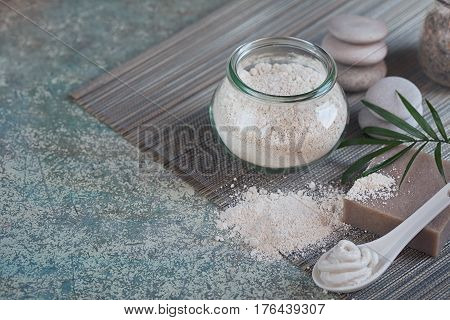 Natural ingredients for homemade facial and body mask or scrub. White clay and natural homemade soap. Spa and bodycare concept.