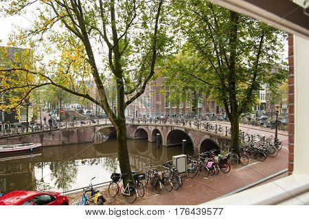The traditional view of Amsterdam's canals, bicycles and peaceful ambiance.
