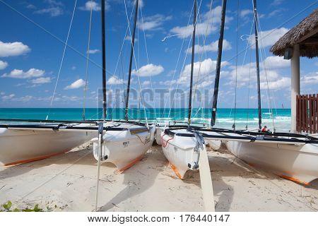 Cayo Santa Maria Cuba - January 31 2017: Catamarans on the empty tropical beach Cuba. Cayo Santa María is well known for its white sand beaches and luxury all inclusive resorts.