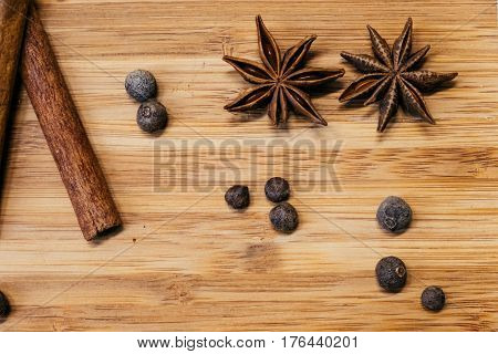 Bad Crushed cinnamon pepper and other spices on a wooden table
