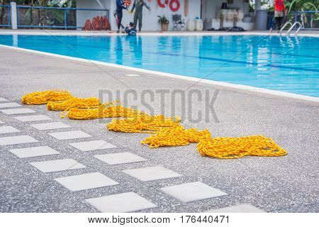 yellow lifeline on the floor pool swimming