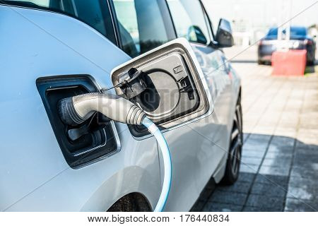 Electric car charging energy in station at an airport