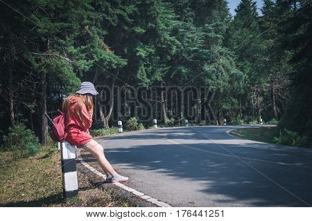 Woman Alone Travel Healthy Lifestyle Concept On The Road In The Forest