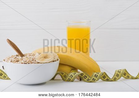 Oatmeal With Banana And Juice Glass