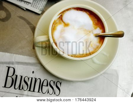 morning coffee and business section of the newspaper at a cafe