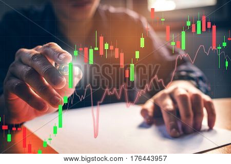 Double Exposure Businessman Writing The Trading Graph Of Stock Market,business Stock Market Concept