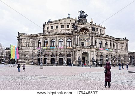 Dresden Germany- January 42017: The Semper Opera House - built by the project of Gottfried Semper. . It was opened in 1841. Near the theater walk tourists