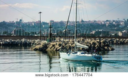 Sailing boat at dock in the beautiful harbor of Giulianova in Abruzzo Italy. The photo is nestled in a picturesque and breathtaking scenery that leaves you speechless. A feast for the eyes.