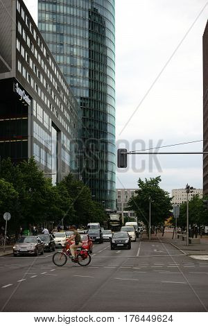 BERLIN, GERMANY - JUNE 21, 2016: Traffic in front of the modern glass facades of the Sony Center and the DB skyscraper on June 21, 2016 in Berlin.