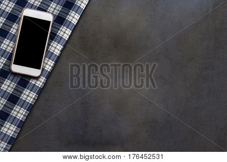 Smartphone and fabric of grid pattern on dark