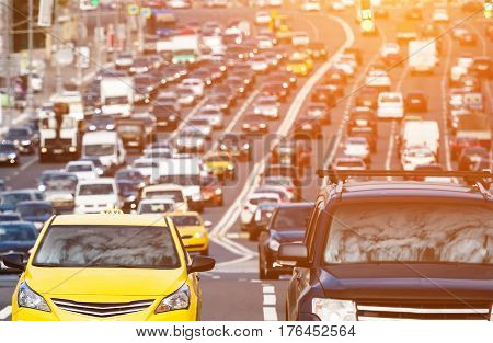 Heavy traffic on the city highway wuth sunlight effect