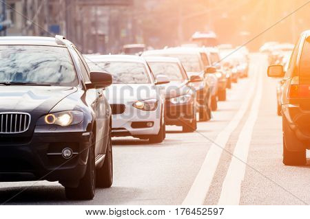 Zoom view of the congested road full of cars with sunlight