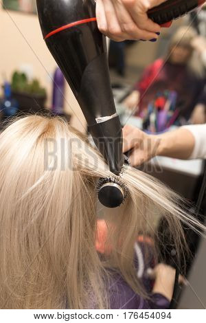 Styling female hair dryer in the beauty salon poster