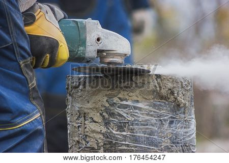 Working circular saw outdoors, sawdust flying around, close up
