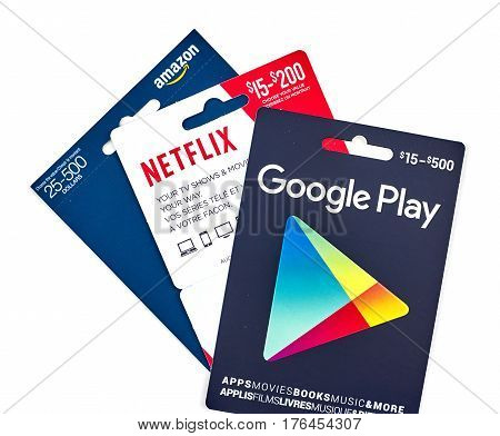MONTREAL CANADA - MARCH 10 2017 : Google Play Netflix and Amazon popular giftcards. The cards are prepaid stored-value money cards issued to be used as an alternative to cash for purchases.