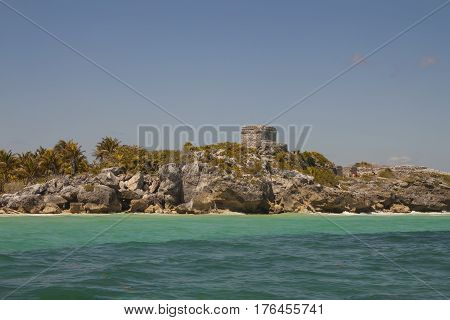 Mayan ruins above limestone cliffs along the shoreline of the Caribbean Sea in Tulum Quintana Roo Mexico