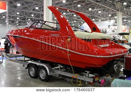 MOSCOW - MARCH 09 2017: Red yacht Magniff for 10 International boat show in Moscow. Russia.