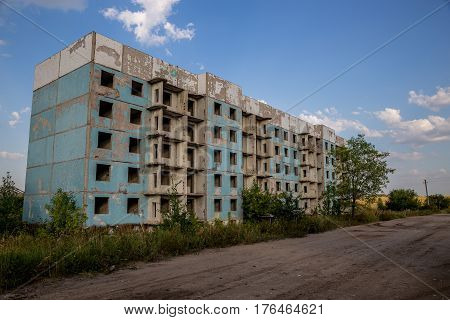Abandoned five-story house in ghost-town, summer, Russia, Samara region