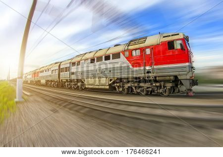 Freight train long locomotive rides speed railway.