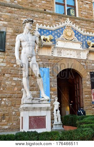 FLORENCE, ITALY - February 18, 2017: copy of the statue David by Michelangelo in front of the entrance of the Palazzo Vecchio, Piazza della Signoria in Florence, Italy