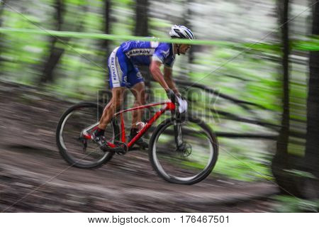 Lviv Ukraine - August 17 2016: Undefined MTB cyclist competing in the forest near Lviv in Ukraine at 4th round of amateur xc cup of Ukraine 2016.