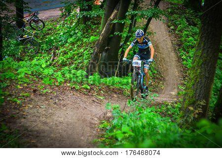 Lviv Ukraine - August 17 2016: MTB cyclist V. Skubenko competing in the forest near Lviv in Ukraine at 4th round of amateur xc cup of Ukraine 2016.