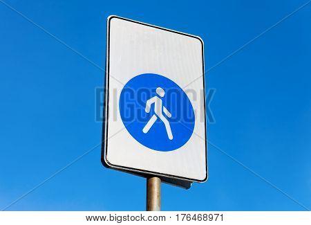 Pedestrian zone. Walkway road sign against blue sky