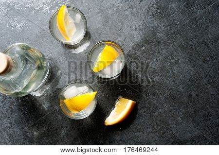 Tequila Vodka Shots With Lemon Slices, Top View