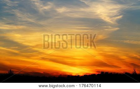 Photo of a beautiful beautiful sunset over the summer day field