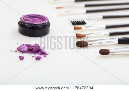 Eye Shadow And Brushes On White Background