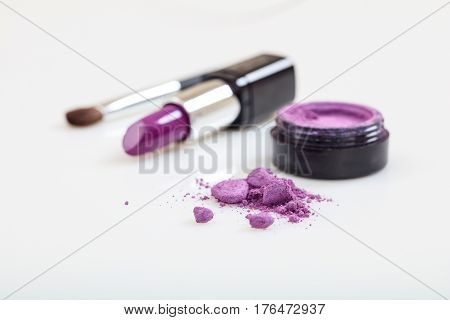 Lipstick And Eye Shadow Isolated On White Background
