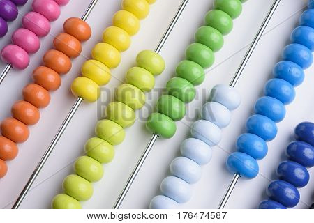 Close up wooden abacus on white background