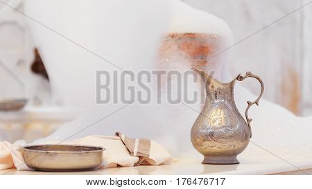 Making Soap Foam For Massage. Water Jar, Towel And Copper Bowl With Soap Foam In Turkish Hamam. Trad