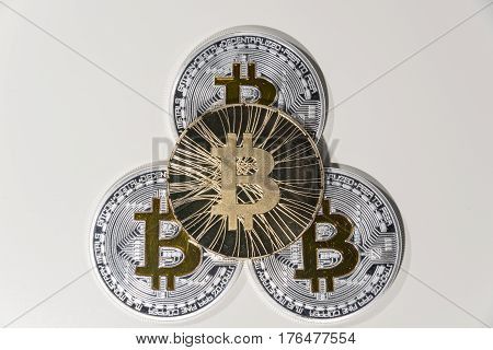 Shining metal BTC bitcoin coins on white background.