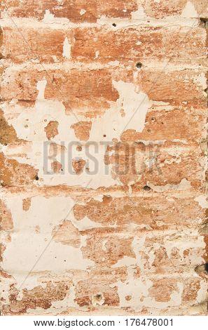 Orange grunge wall in old village or town