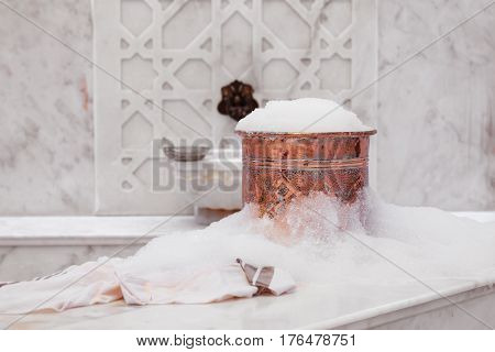 Towel And Copper Bowl With Soap Foam In Turkish Hamam. Traditional Interior Details