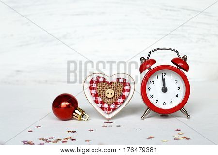 Midnight clock and Christmas decoration on white background