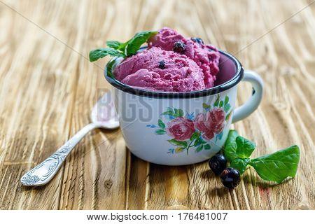 Berry Ice Cream And Mint In Enamel Mug.