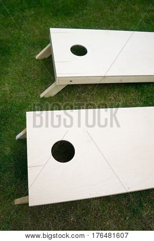 Wooden Cornhole Boards from Above on Grass