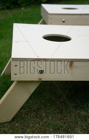 Close-Up of Cornhole Boards on Garden Grass