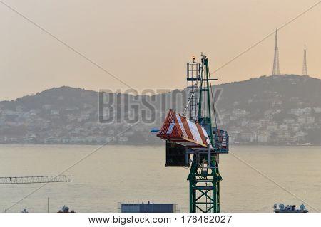 Closeup view of a green tower crane
