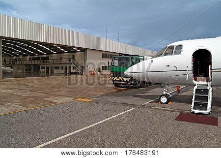 Jet photography ready to board in the background the hangar in sunny day