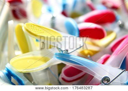 Closeup Of Brightly Colored Clothespins With Selective Focus