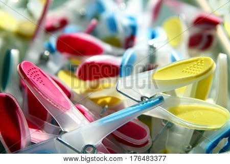 Closeup Of Brightly Coloured Clothes Pegs With Selective Focus