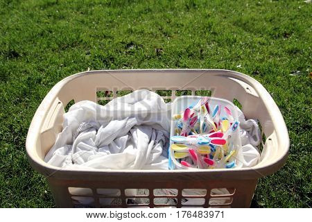 Laundry Basket Full Of Laundry Ready To Be Hung Out With Colorful Clothespins